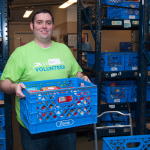 Ben Reavis is the recipient of Symetra's seventh-annual CEO Service Award, which recognizes employees for exemplary community service. A compliance analyst in the company's Bellevue, Washington, headquarters, Reavis is shown here stocking shelves at the Issaquah Food Bank during the 2016 Symetra Week of Service. (Photo: Business Wire)