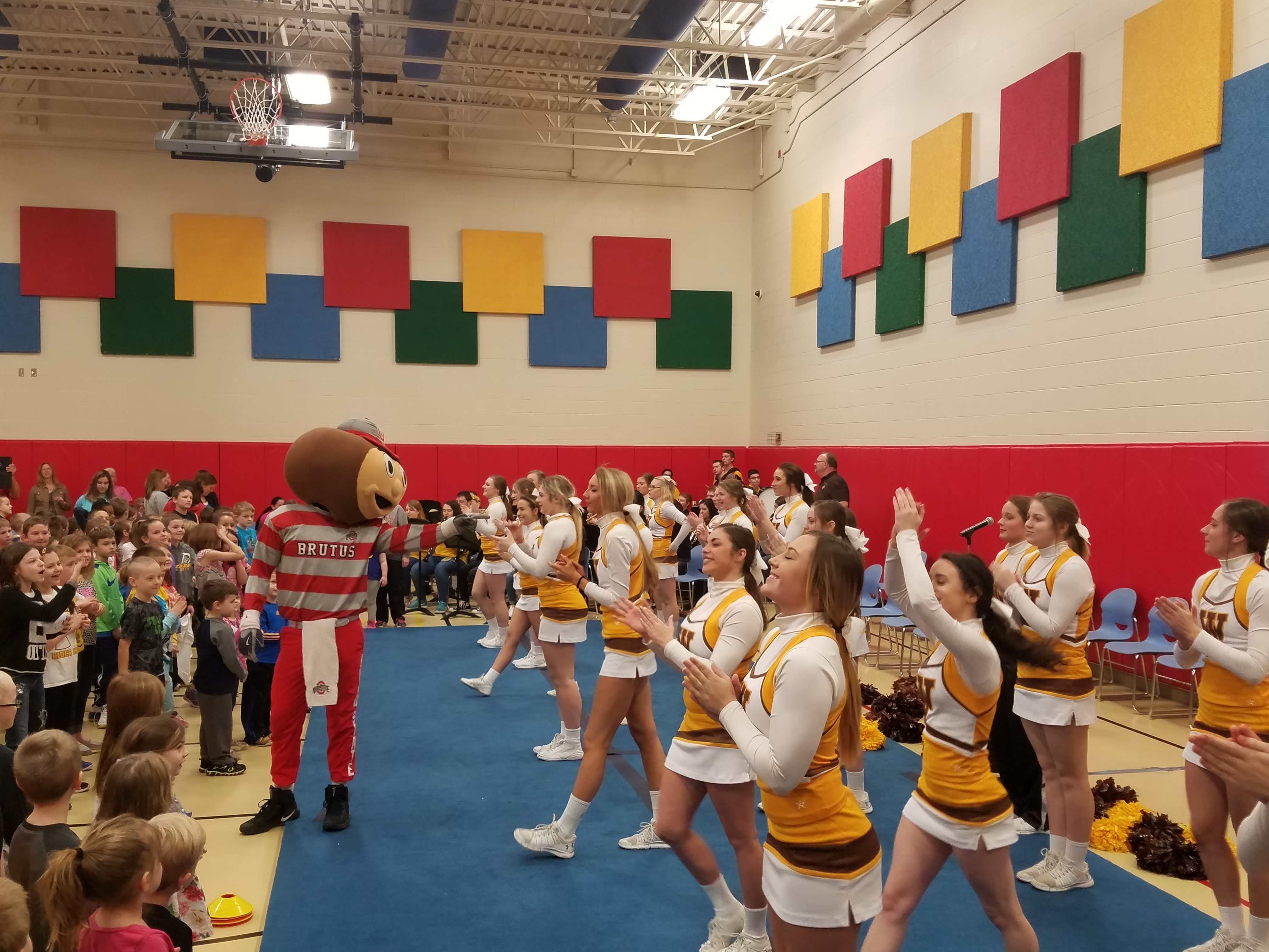 Brutus Buckeye was joined by cheerleaders from West Jefferson High School at Norwood Elementary in West Jefferson today for a school assembly to celebrate Norwood receiving a $20,000 PLAYMAKERS grant from UnitedHealthcare. PLAYMAKERS, created by UnitedHealthcare with support from Ohio State IMG Sports Marketing and 97.1 The Fan, promotes sports, physical activity and active play at elementary schools across Ohio (Photo courtesy of UnitedHealthcare).