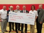UnitedHealthcare presented Norwood Elementary with a $20,000 grant to build a climbing wall as part of PLAYMAKERS, a program from UnitedHealthcare – with support from Ohio State IMG Sports Marketing and 97.1 The Fan. PLAYMAKERS was created to promote sports, physical activity and active play at elementary schools across Ohio. (l to r) Dave Luby, executive director, UnitedHealthcare; West Jefferson school board members Jerry Garman and Jerry Doran; William Mullett, superintendent, Jefferson Local School District; Tracy Davidson, CEO, UnitedHealthcare Community Plan; and West Jefferson school board member Dave Harper (Photo courtesy of UnitedHealthcare).