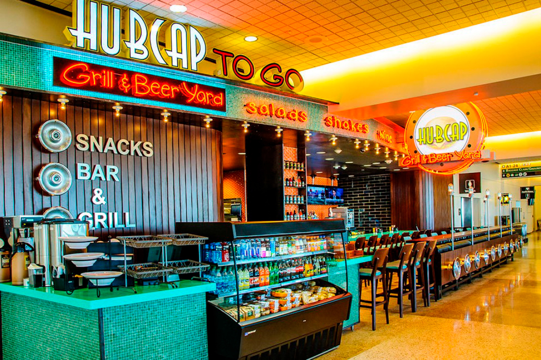 In IAH Terminal A, you can chow down on a Hubcap Grill's Philly Cheesesteak Burger -- voted the fifth-best burger in Texas -- for less than $10. (Photo: Business Wire)