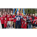 Feature Package - Six Flags Over Georgia near Atlanta opens for its 50th anniversary season by fulfilling its big game bet with sister park, Six Flags New England. Park President Dale Kaetzel wore a Patriots jersey and was surrounded by 31 other fans wearing Falcons shirts on the 240-foot tall thrilling swing ride, renamed for the weekend as, the Patriots SkyScreamer. The park is also serving a limited amount of New England clam chowder to All Season Dining Plan guests during opening weekend. (Photo: Six Flags Over Georgia)