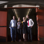 "Colorado State University Global Social and Sustainable Enterprise MBA students, from left to right, Charlie Warden Hannah Holden, Meghan King, and Montana Williams, stand for a portrait after their team ""Business for Good"" was awarded the $10,000 first place prize during the DisCOver Challenge business design competition at University of Denver on March 4, 2017. Photo by Griffin Moores for Colorado State University College of Business."