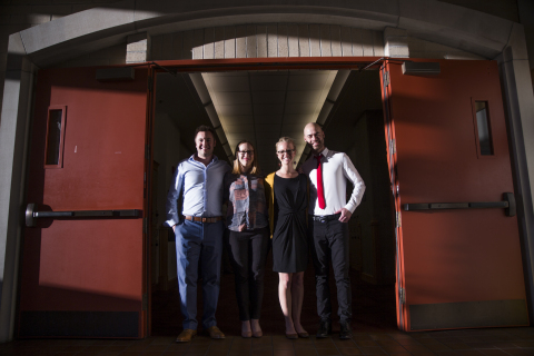 """Colorado State University Global Social and Sustainable Enterprise MBA students, from left to right, Charlie Warden Hannah Holden, Meghan King, and Montana Williams, stand for a portrait after their team """"Business for Good"""" was awarded the $10,000 first place prize during the DisCOver Challenge business design competition at University of Denver on March 4, 2017. Photo by Griffin Moores for Colorado State University College of Business."""