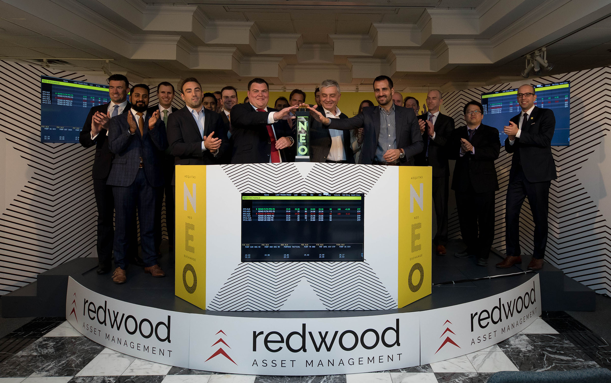"""Redwood Asset Management (""""Redwood""""), a wholly owned subsidiary of Purpose Investments Inc. (""""Purpose""""), including Redwood President, Peter Shippen, and Som Seif, founder and Chief Executive Officer, Purpose, joined Jos Schmitt, President and Chief Executive Officer, Aequitas NEO Exchange Inc. (""""NEO Exchange"""" or """"NEO""""), to open the market in celebration of the launch of two new ETFs, consisting of three ETF listings on NEO. These are the first Redwood ETFs to be launched on the public markets, and will provide investors with a suite of ETF solutions managed by best-in-class specialist investment boutiques. Redwood becomes the fourth ETF issuer to list securities on NEO. The actively managed Redwood ETF listings that began trading on NEO on March 15, 2017, are Redwood Floating Rate Preferred Fund (RPS) and Redwood U.S. Preferred Share Fund (RPU, RPU.B). (Photo: Business Wire)"""