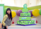"""New Girl"" actress Hannah Simone helps Swiffer celebrate its 18th birthday, Thursday, March 16, 2017, in New York. (Photo by Diane Bondareff/Invision for Swiffer/AP Images)"