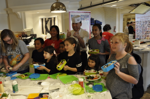 Children and their rice ball characters (Photo: Business Wire)