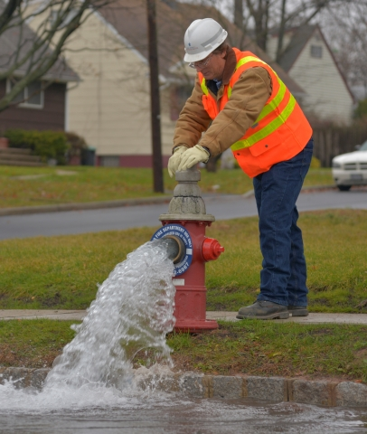 New Jersey American Water's Jerry Castrogiovanni flushing a hydrant in the company's Plainfield serv ...