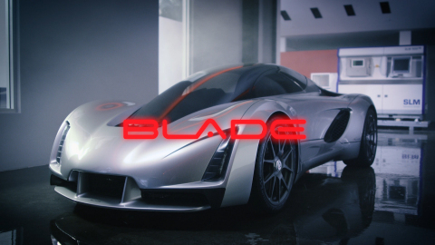 Image of Blade Supercar in front of SLM printer. (Photo: Business Wire)