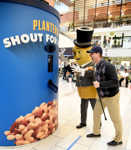 Jim Harbaugh and Mr. Peanut participate in Planters 'Shout For Nuts' at Westfield Culver City. (Photo by Michael Kovac/Getty Images for Planters)
