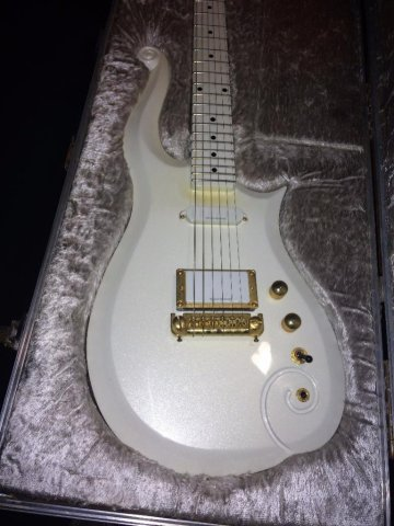 Bid live online on Proxibid for Prince's touring practice guitar, gifted to his former bodyguard. This Schecter Diamond Series-made cloud guitar and other gems could be yours April 1. (Photo: Proxibid)
