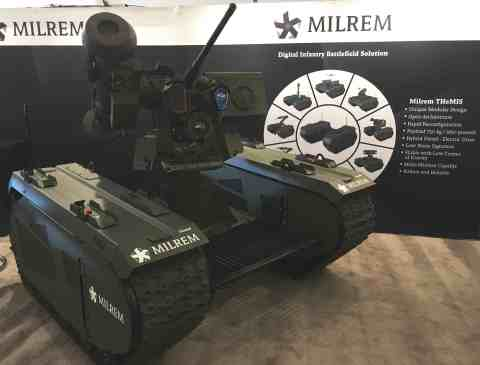 Milrem's fully modular unmanned ground vehicle THeMIS equipped with KONGSBERG PROTECTOR Remote Weapo ...