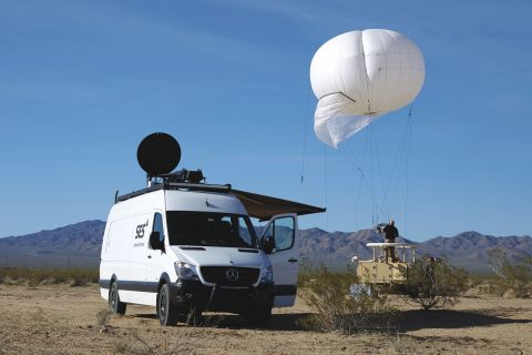 SES's Government+ Rapid Response Vehicle presented at the Humanitarian ICT Forum, and SES's Persistent Surveillance Aerostat (Photo: Business Wire)