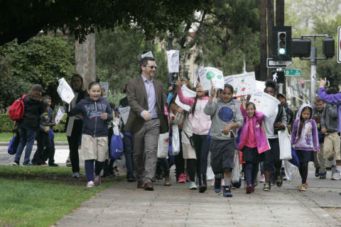 Kevin Kandalaft of UnitedHealthcare leads students from Woodlake Elementary School in Sacramento, Calif., on the first Healthy Ag Walk Wednesday, as part of Ag Day at the Capitol. UnitedHealthcare and the California Foundation for Agriculture in the Classroom hosted the fun walk to highlight nutrition, exercise and educational programs that help people live healthier lives (Photo: Gary Fong).