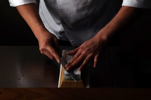 Chef using the Kamikoto Toishi Sharpening Whetstone (Photo: Business Wire)