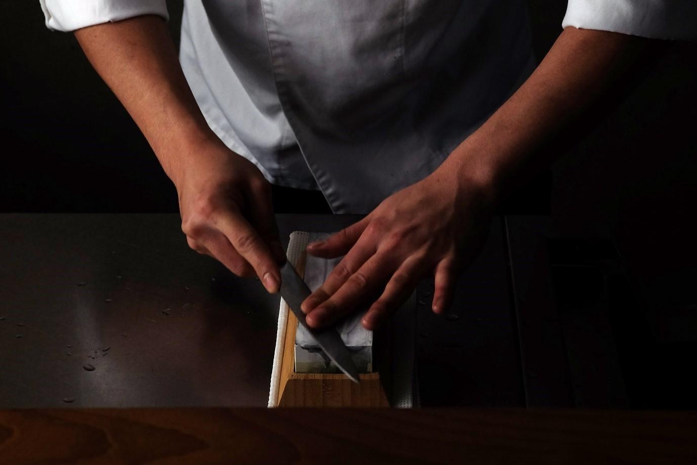 Chef using the Kamikoto Toishi Sharpening Whetstone (Photo: Business Wire)