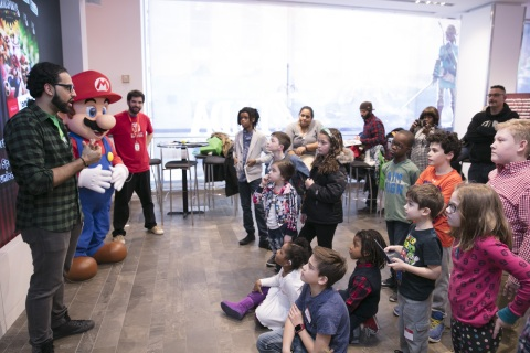 In this photo provided by Nintendo of America, fans gather at the Nintendo NY store in Rockefeller Plaza to celebrate the launch of the Mario Sports Superstars game and compete in an on-site tournament. Fans played five different sports from the game and had the chance to meet Mario. Mario Sports Superstars is an action-packed Nintendo 3DS game that finds players competing in five full-featured sports: Baseball, Soccer, Golf, Tennis and Horse Racing. (Photo: Business Wire)