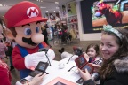 In this photo provided by Nintendo of America, Gia P. from Bronx, NY and Alyssa P. from Bronx, NY meet with Mario at the Nintendo NY store in Rockefeller Plaza on Friday, March 24. Fans gathered to celebrate the launch of Mario Sports Superstars, an action-packed Nintendo 3DS game that finds players competing in five full-featured sports: Baseball, Soccer, Golf, Tennis and Horse Racing. (Photo: Business Wire)