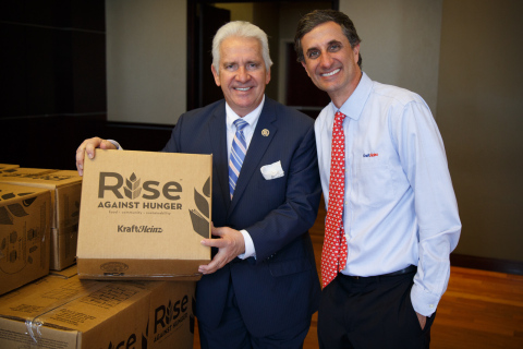 Rep. Jim Costa (D-Calif.) on the left and Kraft Heinz CEO Bernardo Hees (right) joined about 100 par ...