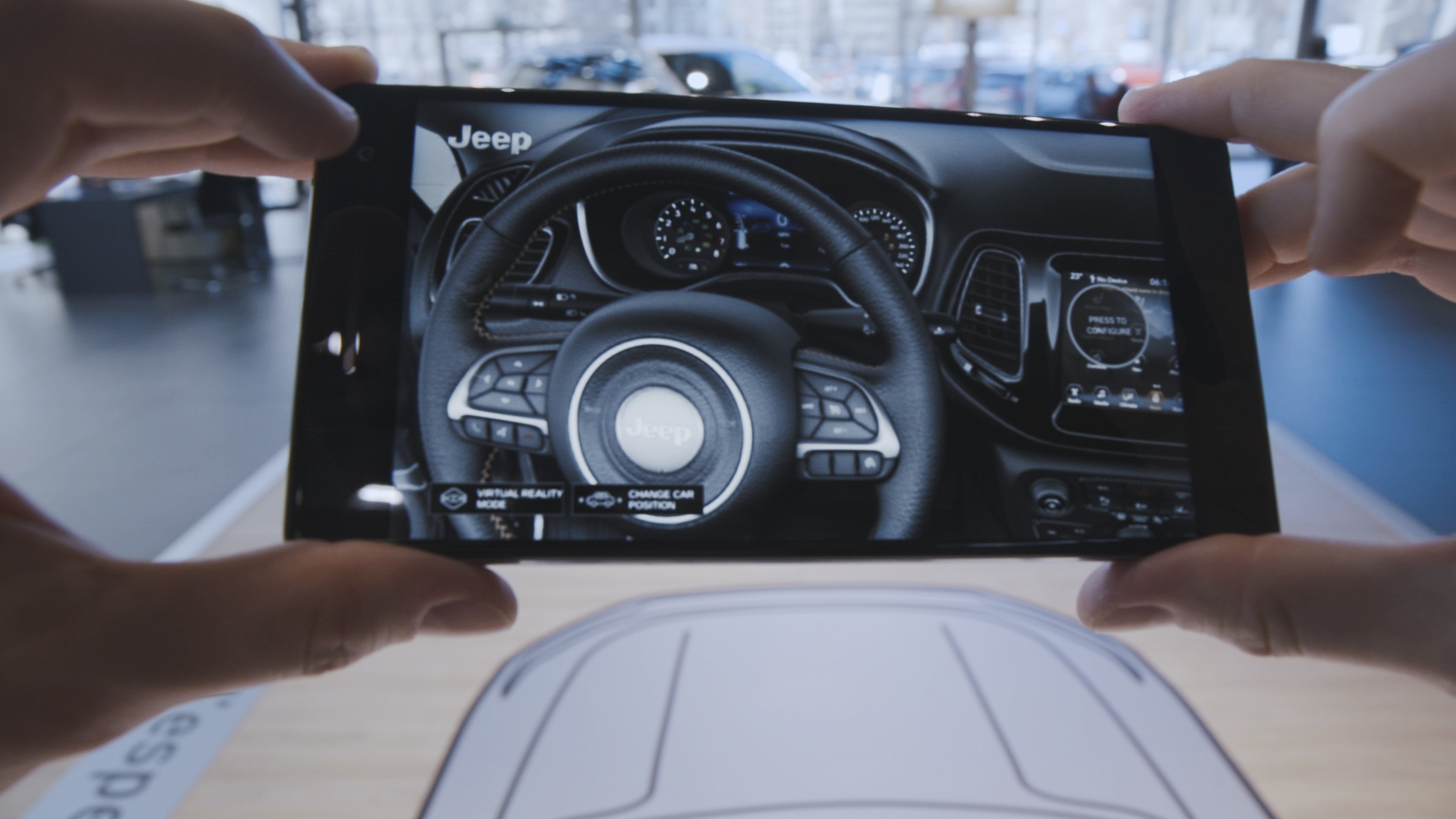 The Accenture-developed app allows car buyers to hold a Tango-enabled device and view, walk around, look inside and configure a life-size virtual Jeep Compass (Photo: Business Wire)