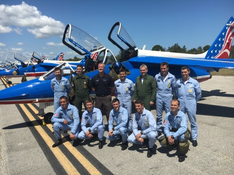 Executive Director Greg Donovan, A.A.E. (black shirt) stands proudly with the French Air Force's Patrouille de France Jet Demonstration Team at Florida's Orlando Melbourne International Airport (MLB). (Photo: Business Wire)