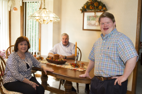 Teddy Kremer (right) and his parents Chery and Dave, say ABLE accounts help people with disabilities save money without losing important federal benefits. (Photo: Business Wire)