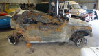 Post-accident view of the Almanza and Urquiza family's burned-out Jeep Liberty. (Photo: Business Wire)