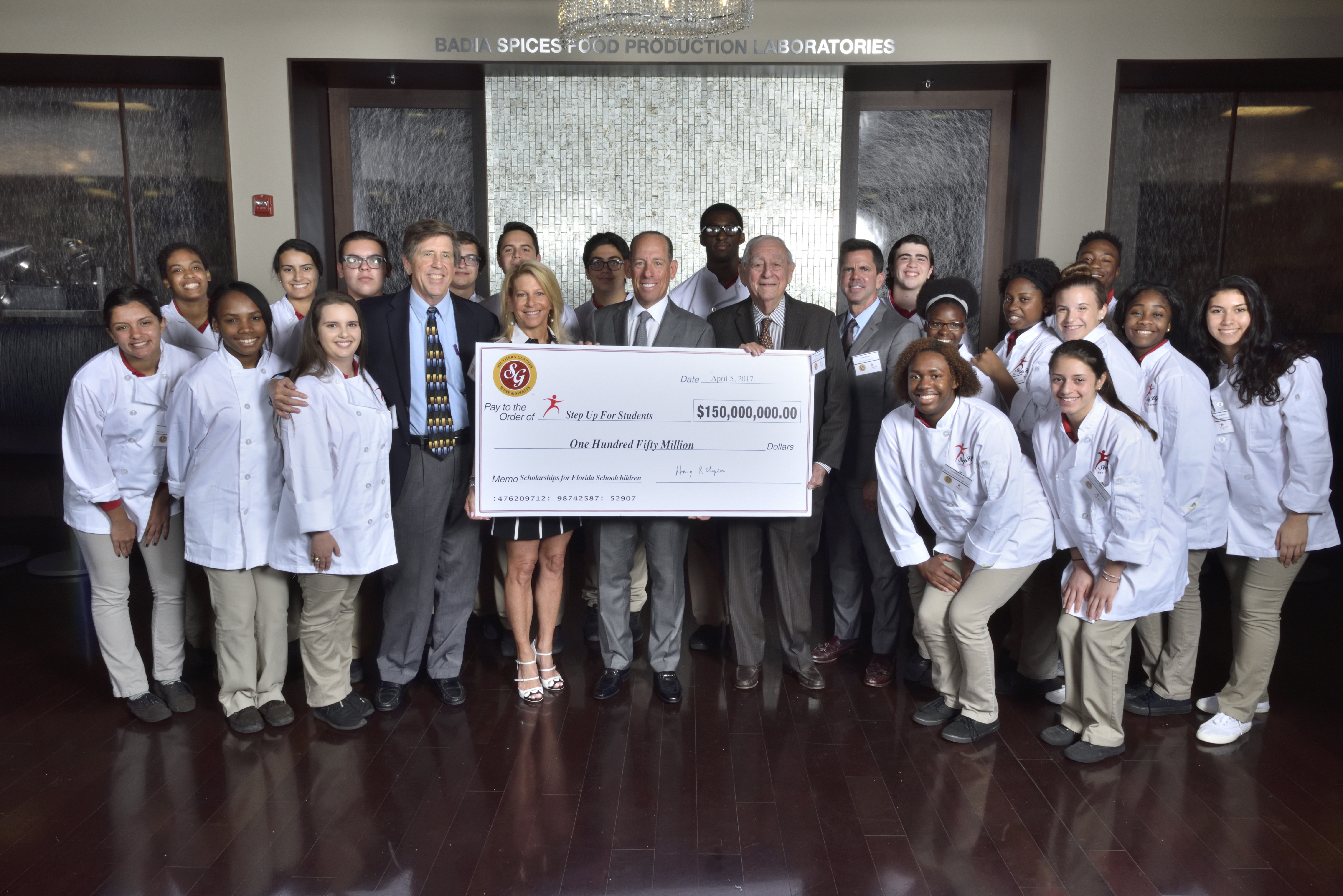 Southern Glazer's Wine & Spirits commits $150 Million to Step Up For Students Scholarship Program for the 2017/2018 school year (Pictured left to right, front row with Step Up For Students scholarship recipients from Monsignor Edward Pace High School) Dough Tuthill, President, Step Up For Students; Terry Jove, Director Charitable Giving, Southern Glazer's; Wayne Chaplin, CEO, Southern Glazer's, Harvey Chaplin, Chairman, Southern Glazer's; and John Kirtley, Founder and Board Chairman, Step Up For Students (Photo: Business Wire)