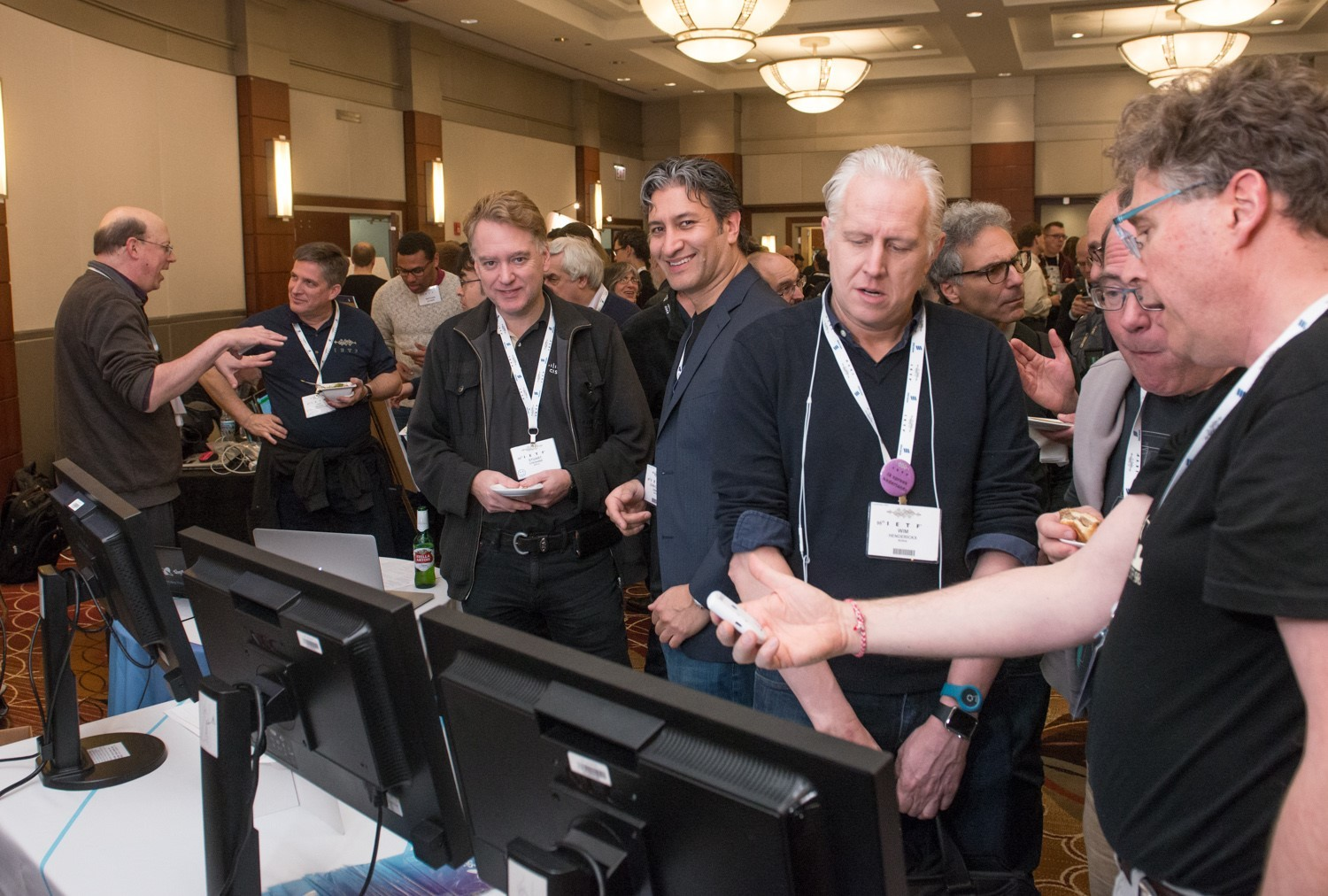 Juan Carlos Zuniga, senior standardisation expert at Sigfox, and co-chair of the IETF IntArea working group, and Stuart Cheshire (Apple), inventor of the Bonjour protocol (AirPlay, AirPrint, AirDrop, etc.), during the Sigfox demonstration at IETF. ©Stonehousephotographic/IETF