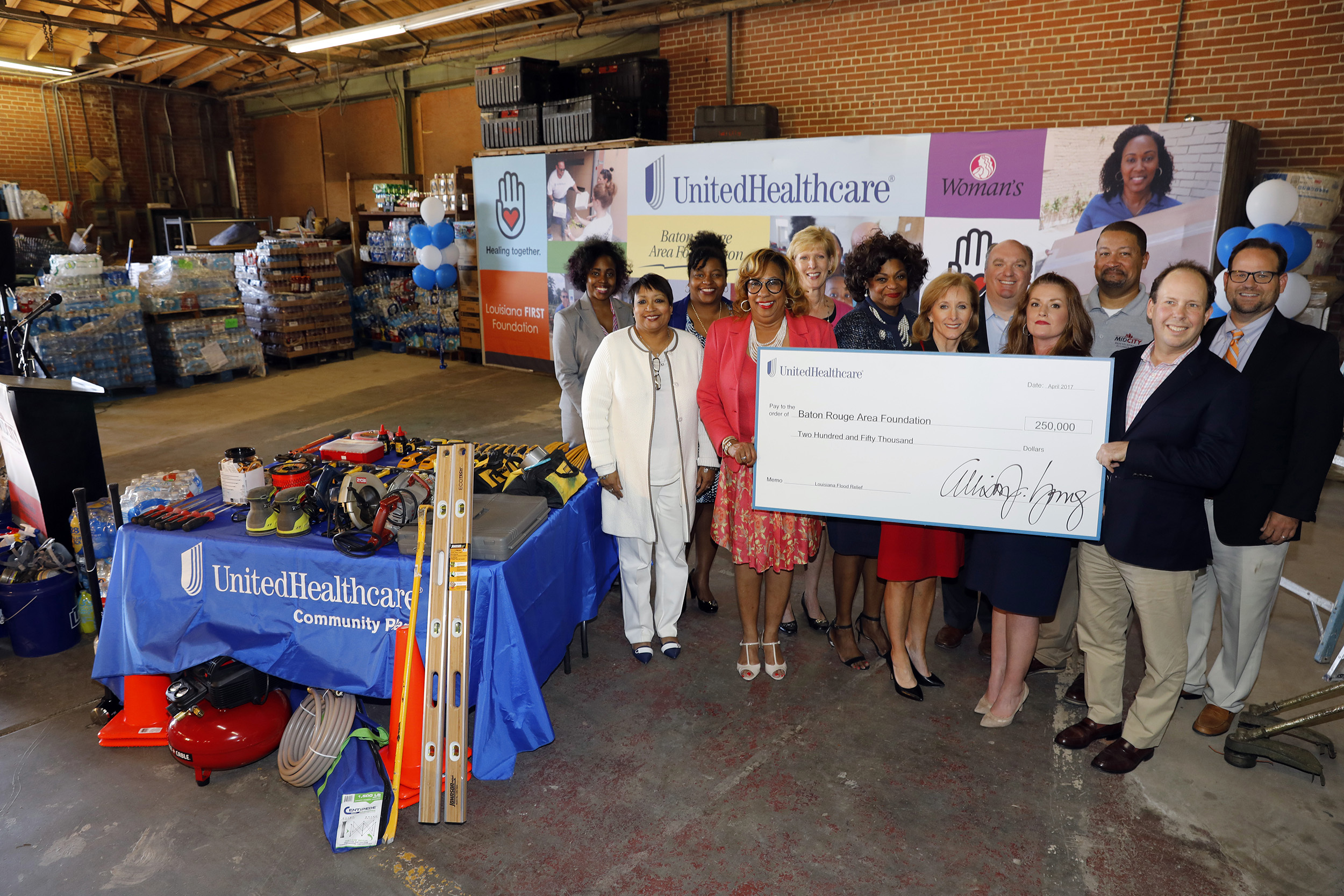 Baton Rouge Area Foundation received a $250,000 grant from UnitedHealthcare today at a special event hosted by Mid City Redevelopment Alliance Inc. in Baton Rouge, La. The grant will help with relief and recovery efforts from the floods in Southeast Louisiana. Left to right: Jessica Sparks, Virginia Listach, Latisha Nixon-Jones with Southern University Law Center (SULC); Allison Young, UnitedHealthcare; Pam Parker, Woman's Hospital Mammography Coach; Tanya Freeman, SULC; First Lady of Louisiana Donna Edwards; Edmund Giering, Baton Rouge Area Foundation; Rachel Farmer, UnitedHealthcare; Samuel Sanders, Mid City Redevelopment Alliance; Zack Rosenberg, SBP; and Karl Lirette, UnitedHealthcare (Photo: Tim Mueller).