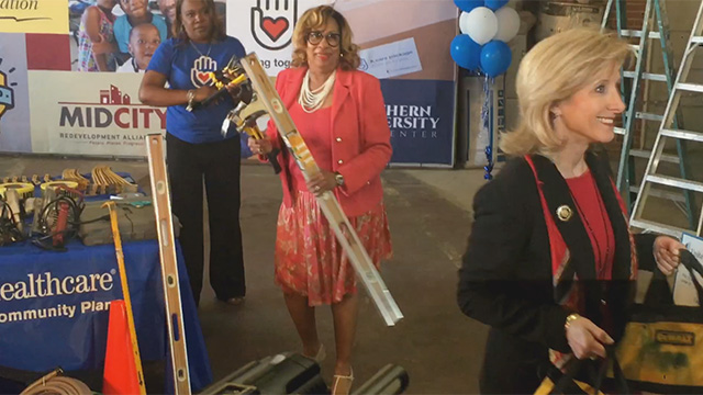 B-roll of First Lady Edwards, UnitedHealthcare employees and volunteers loading construction material into a trailer set to go into the community to help in the repair of damaged residences and storefronts (Video: Kevin Herglotz).