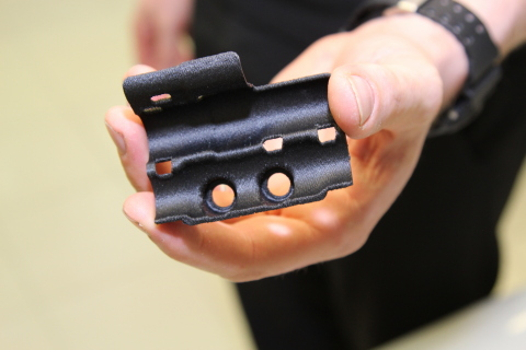 Hydraulic line bracket for the McLaren MCL32 race car, 3D printed on a Stratasys FDM 3D Printer using Nylon12CF material (Photo: Stratasys)