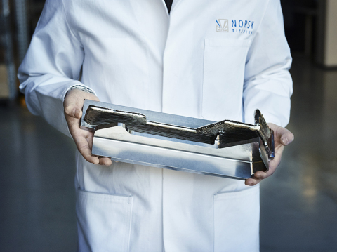 A Norsk Titanium Scientist Displays a Boeing 787 Dreamliner Structural Component to Demonstrate the Near-Net-Shape RPD Buy-to-Fly Ratio (Photo: Business Wire)