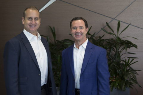 Congressman Mario Diaz-Balart meets with Harris Corporation Chairman, President and CEO Bill Brown during a visit to the company's headquarters in Melbourne, Florida. (Photo: Business Wire)