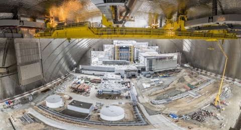 PaR Systems TensileTruss™ with Mobile Tool Platform (MTP) and Main Cranes System (MCS) (yellow-colored equipment shown at top) inside the New Safe Confinement arch, before the slide over the reactor. (Photo: Mammoet)