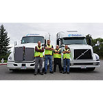 Peloton Drivers in front of Peloton-equipped Volvo and Kenworth trucks. (Photo: Business Wire)