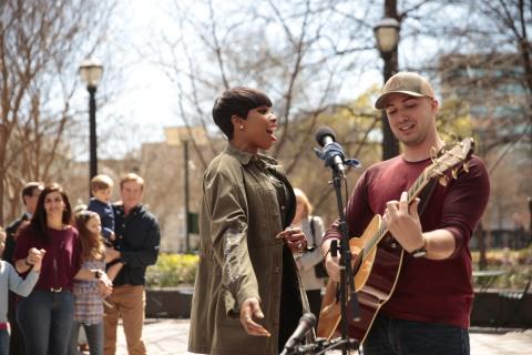 Academy Award-Winning Actress and Grammy Award-Winning Recording Artist, Jennifer Hudson, Surprises Fan in Woodruff Park, Atlanta.  Photo courtesy of Bil Zelman.