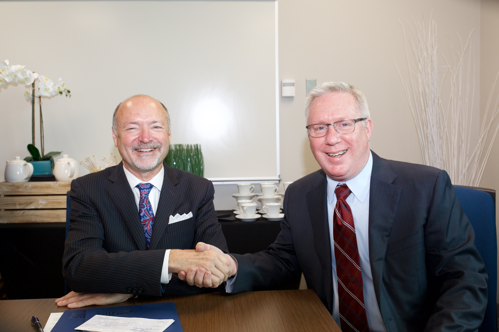 (Pictured left to right) J. David Armstrong Jr., President Broward College and Bill Grubbs, President and CEO of Cross Country Healthcare (Photo: Business Wire)