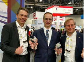 Fredrik Nilsson (left), VP of Americas, James Marcella (center), director of technical services, and Martin Gren (right), Axis co-founder, accepted the SIA New Product Showcase award for Site Designer and Q6155E PTZ at ISC West 2017. (Photo: Business Wire)