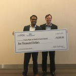Sumit Dalwadi, winner of the 2017 Asian American Hoteliers of America (AAHOA) Community Hotelier of the Year Award, presented by P&G Professional is awarded his prize - a donation in his name to charity: water - by Chris Gaunt, Hospitality Manager, P&G Professional North America. (Photo: Business Wire)