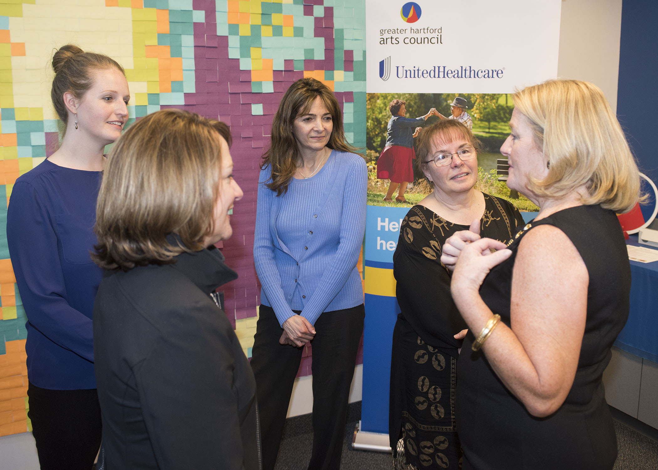 """Elizabeth Winsor, CEO, UnitedHealthcare National Accounts (second from left), and Cathy Malloy, CEO, Greater Hartford Arts Council (GHAC; far right) talk to Katie Hanley from OakHill, Susan Mazar from Charter Oak Cultural Center and Karin Dionne from Harc, Inc. (left to right) about their 2017 GHAC """"Arts + Wellness"""" Grants programs. Grants, supported by UnitedHealthcare, were given to four local arts organizations to produce programs that use creativity to enrich the lives and enhance the health and well-being of adults with physical disabilities and their families. [PHOTO CREDIT: Alan Grant, Digital Creations]"""