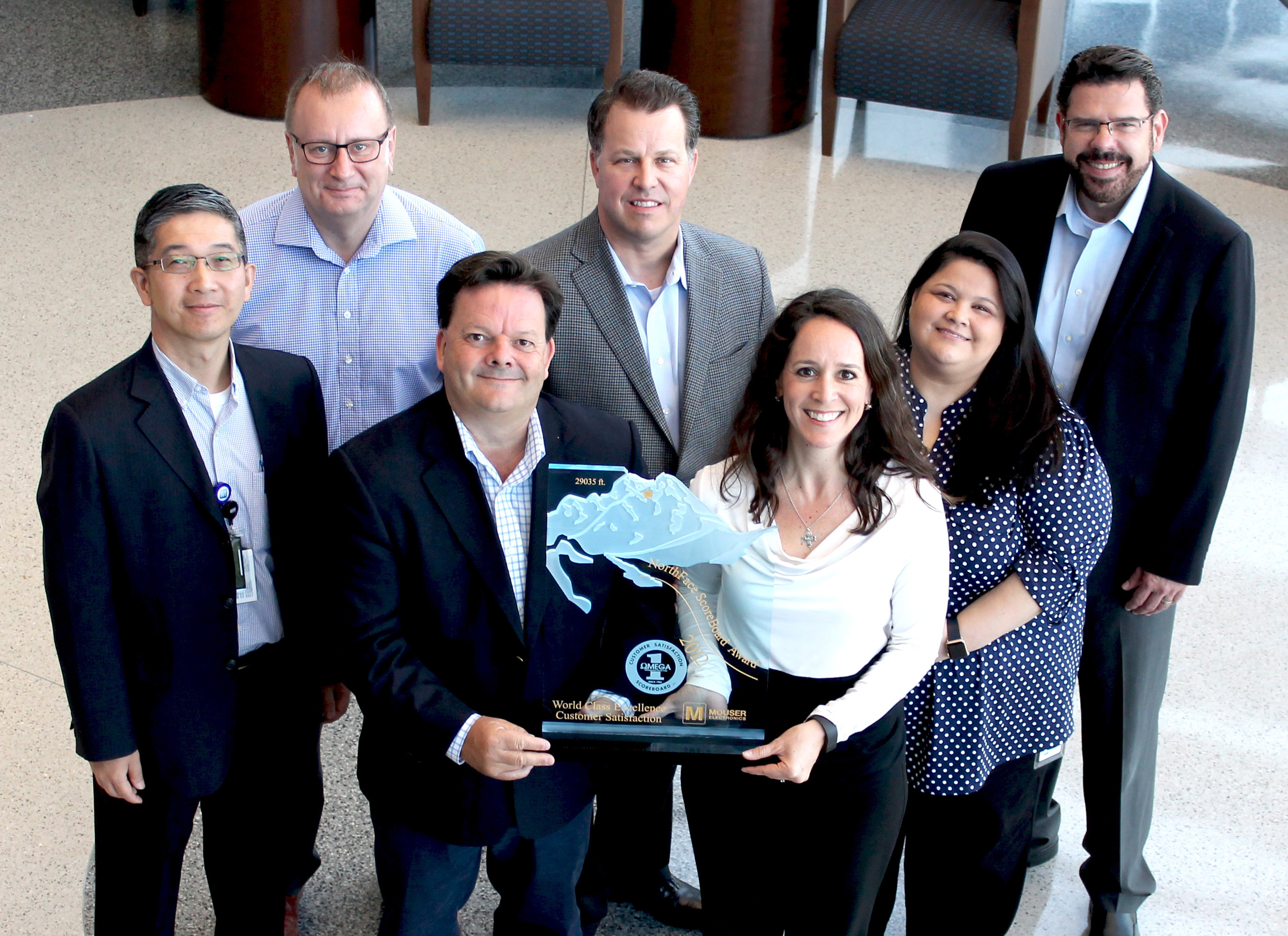 For the fifth consecutive year, Mouser Electronics has received the NorthFace ScoreBoard Award from Omega Management Group Corp. for world-class customer service excellence. Pictured left to right in back are Mouser executives Minky Lam, Graham Munson, Coby Kleinjan, Linda Salinas, Mauro Salomao. In front holding trophy are Mark Burr-Lonnon and Stephanie Sorrell. (Photo: Business Wire)