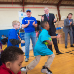 "Stephen photo caption: UnitedHealthcare donated 500 NERF ENERGY Game Kits to the Boys & Girls Clubs of Providence as part of a national initiative to encourage young people to become more active through ""exergaming."" Stephen Farrell, CEO, UnitedHealthcare of New England, and volunteers from UnitedHealthcare cheered for members as they ran through exercises and drills to showcase the activity tracker and mobile game. Throughout 2017, UnitedHealthcare will deliver a total of 10,000 NERF ENERGY Game Kits to elementary schools and community organizations across the country, enabling children ages six to 12 to receive the kits at no cost (Photo: Gretchen Ertl)."