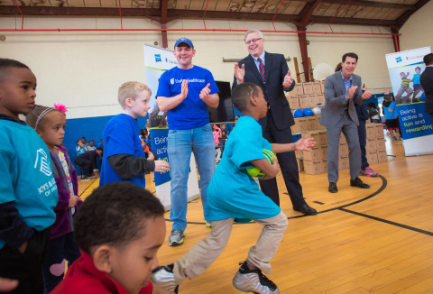 """Stephen photo caption: UnitedHealthcare donated 500 NERF ENERGY Game Kits to the Boys & Girls Clubs of Providence as part of a national initiative to encourage young people to become more active through """"exergaming."""" Stephen Farrell, CEO, UnitedHealthcare of New England, and volunteers from UnitedHealthcare cheered for members as they ran through exercises and drills to showcase the activity tracker and mobile game. Throughout 2017, UnitedHealthcare will deliver a total of 10,000 NERF ENERGY Game Kits to elementary schools and community organizations across the country, enabling children ages six to 12 to receive the kits at no cost (Photo: Gretchen Ertl)."""