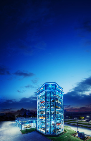 Carvana's Frisco, Texas Car Vending Machine stands eight stories tall, contains four delivery bays and holds up to 30 cars. Upon completing the entire vehicle purchase process online, customers can opt to pick up their vehicle from the new Frisco Car Vending Machine, or choose to receive as-soon-as-next-day delivery service within 100 miles of the Dallas metropolitan area. (Photo: Business Wire)