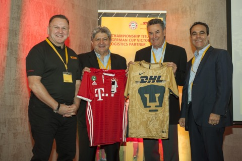 At the launch of DHL ecommerce operations in Santiago de Chile today, Charles Brewer, Global CEO, DHL eCommerce, Hugo Donoso, Country Manager for DHL ecommerce Chile, Lee Spratt, CEO for DHL eCommerce Americas, and Paul Tessy, CEO for DHL eCommerce Latin America and Canada, raffled two team jerseys signed by local soccer stars. (Photo: Business Wire)