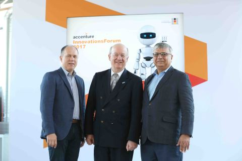 Celebrating the collaboration between Accenture and DFKI: Frank Riemensperger, country managing director, Accenture, Germany, Wolfgang Wohlster, CEO, DFKI and Narendra Mulani, Chief Analytics Officer, Accenture Analytics. (Photo: Business Wire)