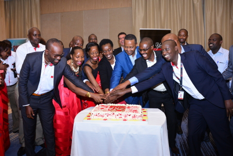 Rwanda's Minister of Health,  AHF staff and Partners cut the anniversary Cake. (Photo: Business Wire)