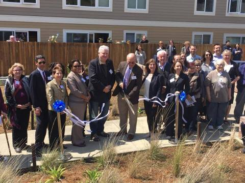 Residents, government officials and business partners cut the ribbon to rededicate Ocean View. (Photo: Business Wire)