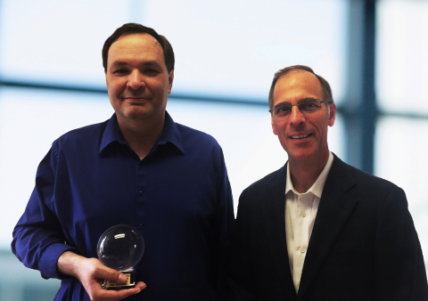 Moody's Analytics Chief Economist, Mark Zandi, and Director of house price research, Andres Carbacho-Burgos, celebrate winning the Crystal Ball award for accuracy of US home price forecasts (Photo: Business Wire)