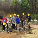 Members of the Mountain Tough Recovery Team, the Appalachia Service Project and area leaders break ground on a new home for Glenna Ogle (blue jacket) in Gatlinburg, Tennessee on Tuesday morning. (Photo: Business Wire)